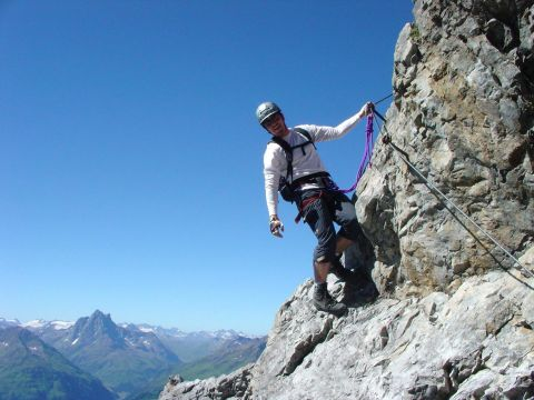 Climbing a rock in St. Anton at the Arlberg
