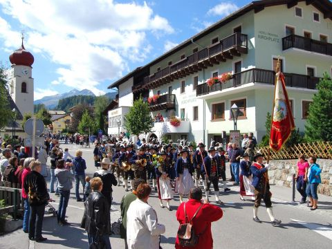 Music group celebrating a festival in St. Anton
